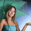 Stock Photo: Happy girl in the rain