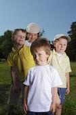 Four boy in row — Stock Photo