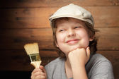Happy boy with paint brush — Stock Photo