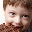 Happy boy with chocolate bar — Stock Photo #22078737