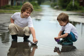 Two boy play in water — Stock Photo