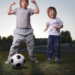 Two happy boy play in soccer — Stock Photo
