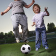 Two happy boy play in soccer — Stock Photo #22791040