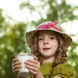 Girl with milk glass — Stockfoto