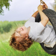 Stock Photo: Happy boy on swing outdoors