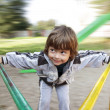 Happy boy on carousel outdoors - Stock Photo