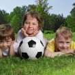 Happy boys with soccer ball — Stock Photo #23625035