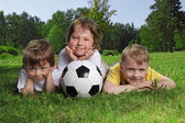 Happy boys with soccer ball — Stock Photo