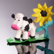 Plasticine cow with flower — Stock Photo #34713411
