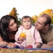 Stock Photo: Happy family autumn outdoors