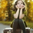 Stock Photo: Resentful girl on suitcase