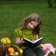 Beauty girl  read book outdoors — Stock Photo