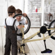 Two boy  repairing bicycle — Stock Photo