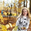 Stock Photo: Happy children in autumn park