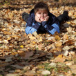 Children in autumn leaf — Stock Photo