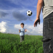 Two boy play in ball outdoors — Stock Photo