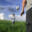 Two boy play in ball outdoors — Stock Photo #34718551