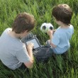 Boy with tablet pc outdoors — Stock Photo