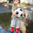 Happy boy with ball outdoors — 图库照片
