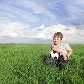 Happy boy with ball outdoors — Stock Photo