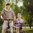 Family on bike cycling in park — Stock Photo