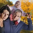 Happy family  autumn outdoors — Stock Photo