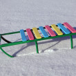 Children sled on snow — Stock Photo