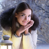 Beautiful girl on winter forest with lantern — Stock Photo