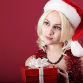 Beauty girl with red gift box — Stock Photo