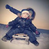 Happy boys on sled — Stockfoto