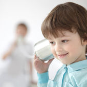 Beauty boy listen tin can telephone — Stock Photo