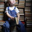 Children reach for a book — Stock Photo