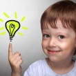 Happy boy with idea lamp on grey background — Stock Photo #38844999
