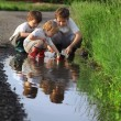 Three boy play in puddle — Stock Photo #39423301