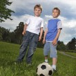 Two happy boy play in football — Stock Photo