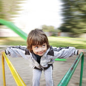 Happy boy on carousel outdoors — Stock Photo