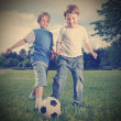 Two happy boy play in soccer — Stock Photo #39951711
