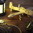 Stock Photo: Hand made children airplane on wood table