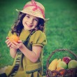 Girl with fruit in park — Stock Photo #41089777