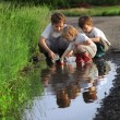 Three boy play in  puddle — Stock Photo #41089915