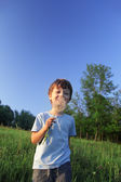 Beauty boy with dandelion — Stockfoto