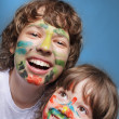Two cheerful brothers with painted faces — Stock Photo