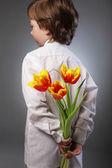 Little boy hides behind surprise — Stock Photo