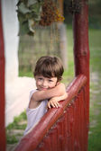 Boy happy on the porch of an old house — Stock Photo