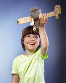 Boy playing with a paper airplane — Foto Stock