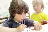 Children draw in home — Stock Photo