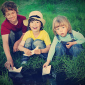 Three boy play in  stream — Stock Photo
