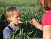 Boy with mom eats  — Stock Photo