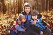 Three happy boys  in autumn forest — Stock Photo