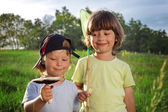 Two other children walking rural with mushroom, net — Stock Photo